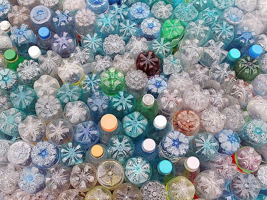 Dirty used colored plastic bottle pile ready to be recycled (©sebasnoo/shutterstock)